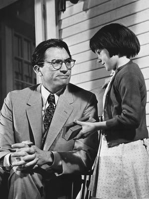 """Gregory Peck and Mary Badham starred as Atticus and Scout Finch in the 1962 film version of Harper Lee's """"To Kill a Mockingbird."""""""