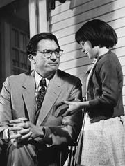 "Gregory Peck as Atticus Finch and Mary Badham as Scout Finch in the 1962 film version of Harper Lee's ""To Kill a Mockingbird."""