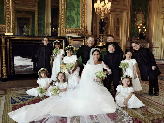 Harry and Meghan pose with their bridesmaids and pageboys.