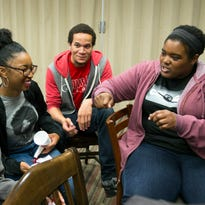 Google software engineer and Google In Residence Sabrina Williams, right, talks with students including, from left, freshmen Lucretia Williams, Alanna Walton and Christopher Hocutt, during a class at Howard University in Washington, D.C., on April 14. In ongoing efforts to diversify Silicon Valley's tech sector, Google is embedding engineers at a handful of historically black colleges and universities where they teach, mentor and advise on curriculum.