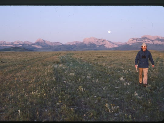 Ivan Doig pacing off shadow at dawn along the Rocky Mountain front