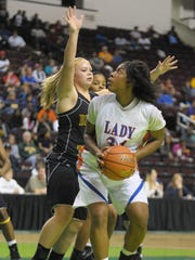Southwood's Kourtney Pennywell looks to shoot past Benton's Madi Sessions during second half action of the Doc Edward's girl's basketball finals game in 2011.