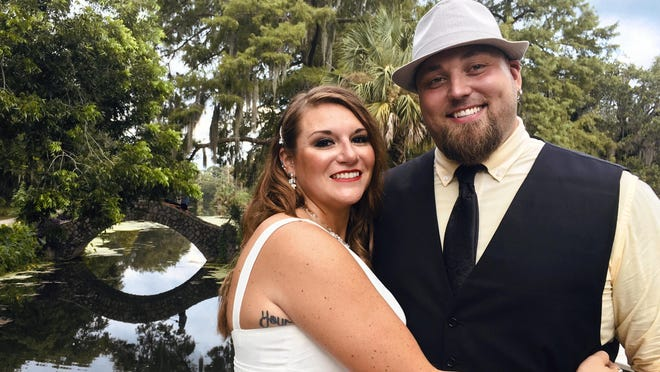 Jordan Tyler, right, and his wife, Brittany Tyler, are shown in New Orleans on July 18. The couple signed up for Match.com, started texting March 18 and were wed by July.