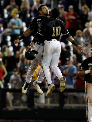 John Norwood (10) and Zander Wiel celebrate after Vanderbilt defeated Texas to advance to the College World Series finals.