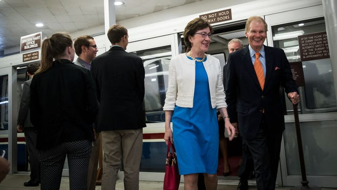 Sens. Susan Collins and Bill Nelson walk through the Senate subway on Capitol Hill on July 27, 2017.