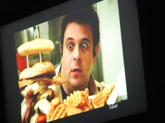 """The Travel Channel's """"Man v. Food"""" host Adam Richman takes a look at the Adam Emmenecker"""" sandwich at Jethro's. The host tried, and failed, to successfully complete the chain's Emmenecker Challenge."""