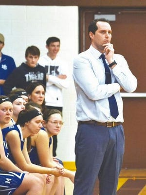 Mackinaw City varsity girls basketball coach Adam Stefanski looks on during a Division 4 regional contest from the 2018-19 season. Stefanski, who guided the Lady Comets to great success during his tenure, is now the athletic director and head varsity girls basketball coach at Boyne City High School.