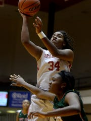 Richmond's Raya Fields shoots the ball against Arsenal Tech's NaJai Howard during a girls basketball game Friday, Dec. 18, 2015, in the Tiernan Center.