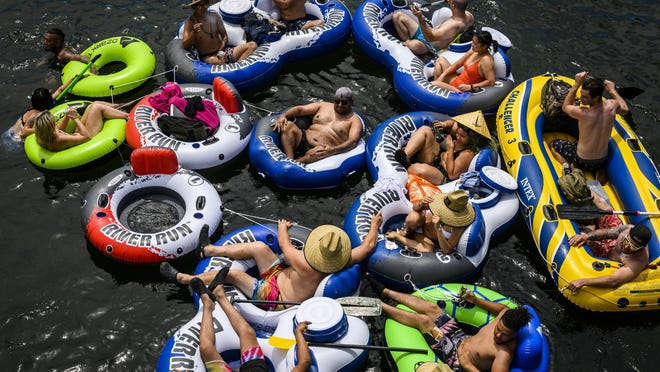 A group of at least 15 people float on connected inflatables down the American River in the Sunrise Recreation Area near Rancho Cordova May 24 during the Memorial Day weekend. [DANIEL KIM/THE SACRAMENTO BEE