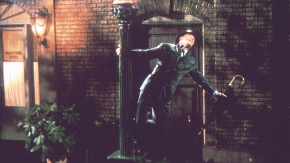 """Gene Kelly dances and sings in the rain in the 1952 musical, """"Singin' in the Rain,"""" showing May 20-26 at Cedarburg's Rivoli Theatre."""