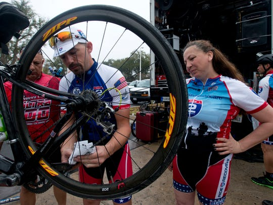 Arleen Agusto, right, looks on as Jeff Krawczyk gets her bike prepared for the ride to Mobile, Ala., on Wednesday morning. The two are part of the Ride 2 Recovery group.