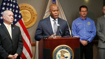 FBI Special Agent in Charge Eric Jackson talks about the FBI's roll in stopping a bomb plot. Acting U.S. Attorney Tom Beall (left) announced Friday a major federal investigation stopped a domestic terrorism plot by a militia group to detonate a bomb at a Garden City apartment complex where a number of Somalis live.Two Liberal men and a Dodge City resident were arrested and charged in federal court with domestic terrorism charges, Beall told reporters at a news conference in downtown Wichita.