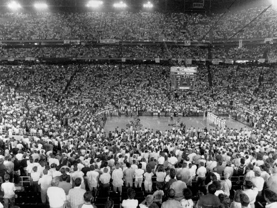 An NBA playoff crowd of 41,732 stands for the national