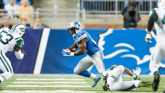 Detroit Lions running back Theo Riddick (25) rushes against the New York Jets during an NFL preseason football game at Ford Field in Detroit, Thursday, Aug. 13, 2015.