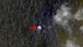 In this March 9, 2014 satellite image seen on the website of the Chinese State Administration of Science, Technology and Industry for National Defense, floating objects are seen at sea next to the red arrow which was added by the source. (AP Photo/Chinese State Administration of Science, Technology and Industry for National Defense)