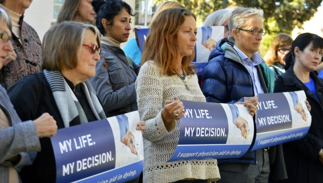 In this Oct. 26, 2015, photo, right to die advocates rally outside the New Mexico Supreme Court in Santa Fe.