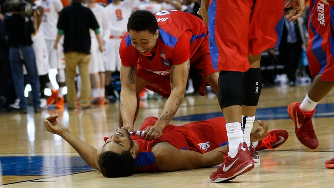 Dayton Flyers guard Kyle Davis (3) celebrates with Dayton Flyers forward Devin Oliver (5) after a men's college basketball game against Syracuse Orange during the third round of the 2014 NCAA Tournament at First Niagara Center.