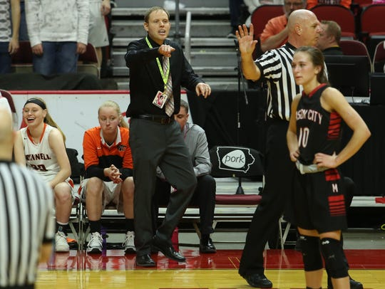 Grinnell Tiger Head Coach Trent Edsen reacts to a call