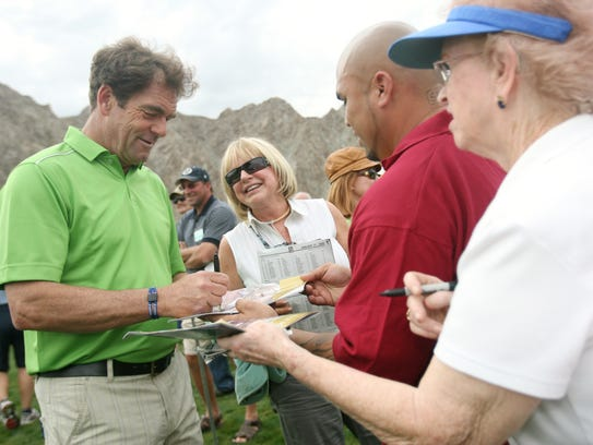 Huey Lewis signs autographs for fans during the 2009
