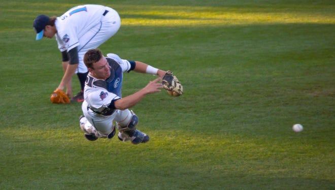 St. Cloud Rox catcher Brendan Illies makes a throw to first Monday night at Joe Faber Field.