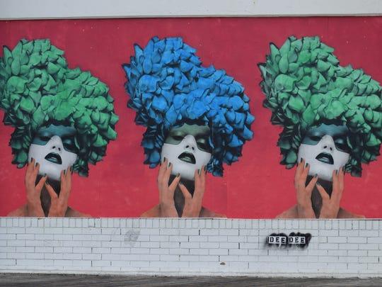 A mural by DeeDee (@deedeewashere).