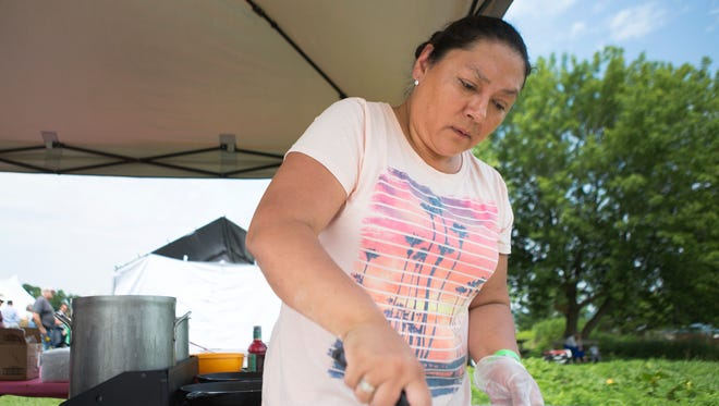 File photo of Gerry Fisher of the Cayuga Nation making fried bread at the Ganondagan Native American Dance and Music Festival on Saturday, July 25, 2015.