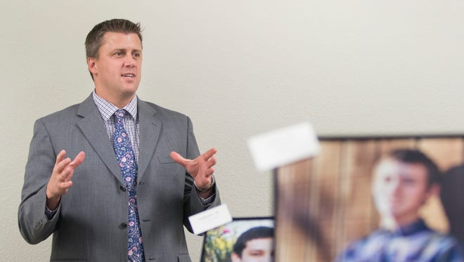 Families First Network President Shawn Salamida helps celebrate National Adoption Month as he talks about adoption on Friday, Nov. 17, 2017, at the Theodore F. Bruno Court House in Pensacola.