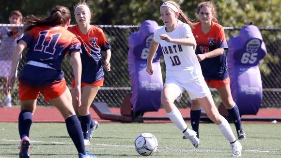 Clarkstown North's Maggie Riordan (10) battles for
