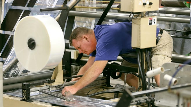 Jack Gaudioso setting up a printing job at Connover Packaging in East Rochester.