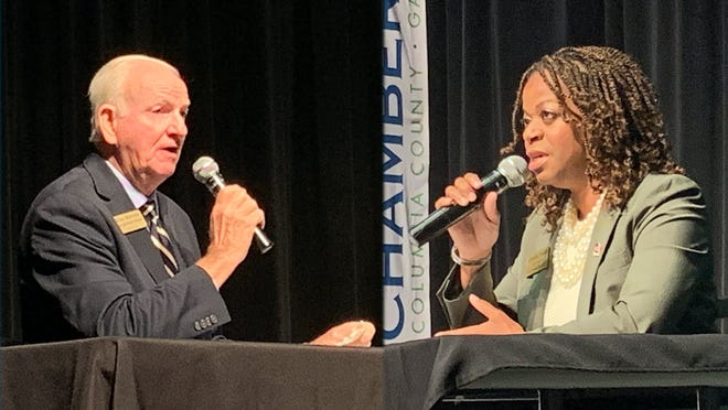 Georgia State Senate District 23 candidates Max Burns, left, and Ceretta Smith, right, discuss their platforms and why voters should pick them in this year's election during a Columbia County Chamber of Commerce forum at Columbia County Library in Evans Wednesday. Oct. 21.