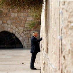 Trump swats away Israel report, while Melania swats away Trump