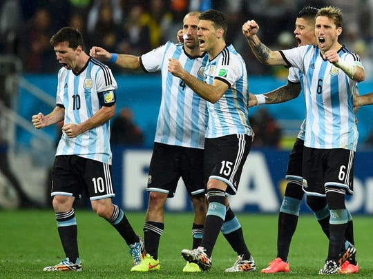 Argentina players celebrate after goalkeeper Sergio Romero makes a second save on a shot at goal by Wesley Sneijder of the Netherlands during a penalty shootout in their 2014 World Cup semifinals at the Corinthians arena in Sao Paulo July 9, 2014.