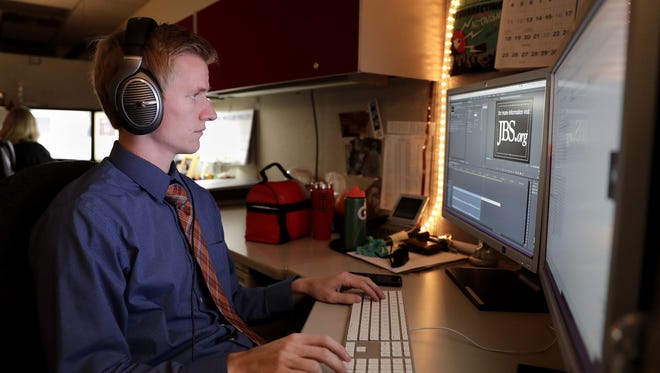 Brennan VanLaanen, a video producer/editor with The John Birch Society, archives videos at their national headquarters Wednesday, Aug. 31, 2016, in Grand Chute, Wis.