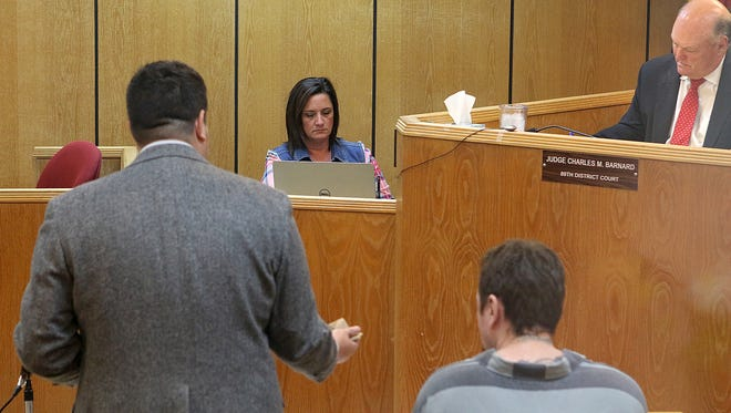 Joanna Beverage, court reporter for the 89th District Court, center, documents what is said during a hearing Tuesday afternoon in the Judge Charles Barnard's courtroom.