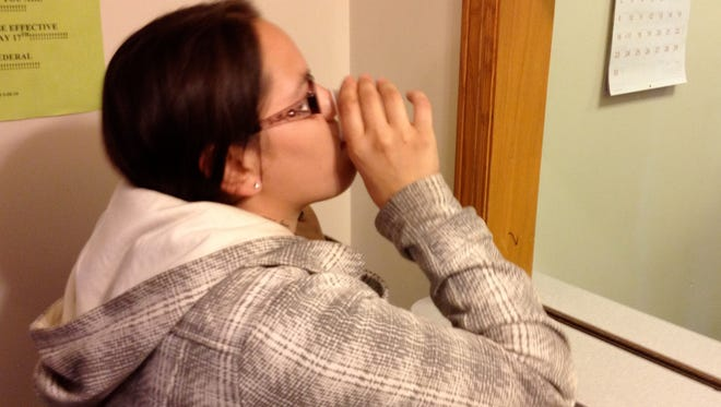Nina Sanchez of Wausau takes her daily dose of methadone at Wausau Health Services in  2012.