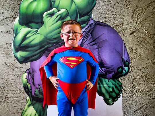 Dylan Marshall, 5, poses in his Superman costume with