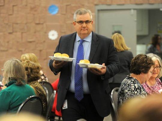 Abilene ISD Superintendent David Young delivers meals to diners during the annual AISD retiree luncheon in December 2016 at the Abilene Civic Center.