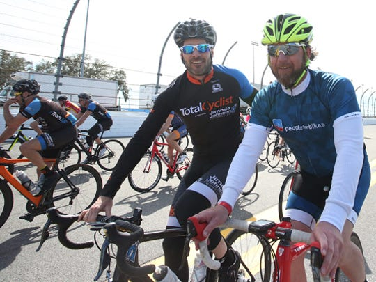 NASCAR champion driver Jimmie Johnson, left, rides with Charlie Cooper, PeopleForBikes' vice president of membership and development. Johnson will take part in the Ride on Atlanta starting March 30 in Asheville.