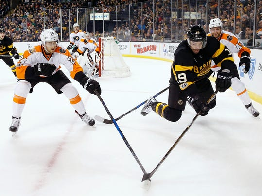 Boston Bruins' Drew Stafford (19) battles Philadelphia Flyers' Matt Read (24) and Andrew MacDonald (47) for the puck during the second period of an NHL hockey game in Boston, Saturday, March 11, 2017. The Bruins won 2-1. (AP Photo/Michael Dwyer)