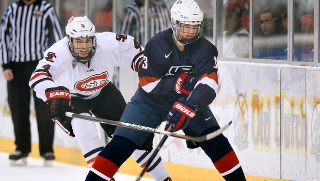 St. Cloud State's Ben Storm tries to get the puck from USA Under-18 National Team's Patrick Khodorenko during the first period Sunday, Jan. 3 at the Herb Brooks National Hockey Center.