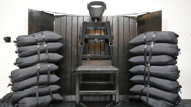 FILE - In this June 18, 2010, file photo, the firing squad execution chamber at the Utah State Prison in Draper, Utah, is shown.