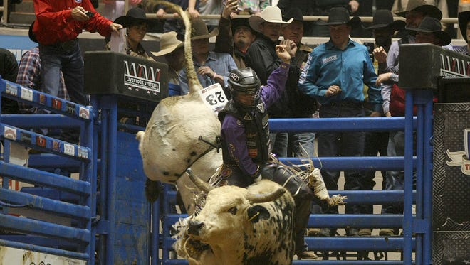 Chandler Bownds rides Big Lew, the 'bounty bull' for a chance at $10,000, during the 15th Bud Light Classic Championship Bull Riding at Oman Arena in Jackson on Friday, Jan. 13, 2017.