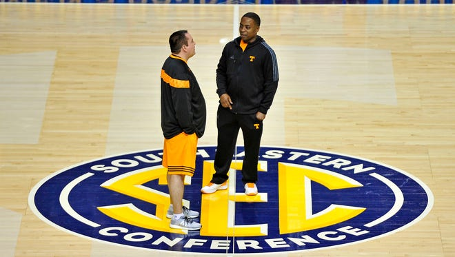 Tennessee head coach Donnie Tyndall, left, talks with J.T. Burton in practice during the SEC Men's Basketball Tournament at Bridgestone Arena in Nashville, Tenn., Wednesday, March 11, 2015.