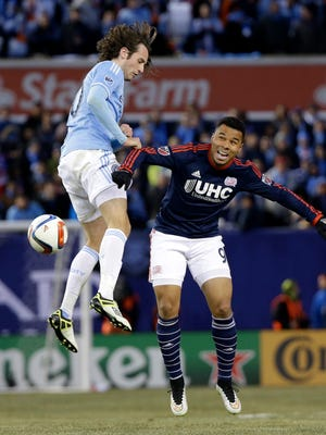 New York City FC's Mix Diskerud, left, and New England's Charlie Davies compete for the ball during the second half Sunday at Yankee Stadium.