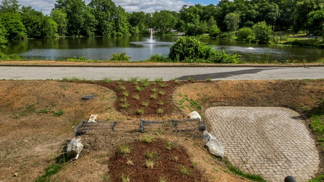 """An overhead view shows the newly constructed filtration and stormwater diversion structure now being built throughout Roger Williams Park. Known as """"green infrastructure,"""" they incorporate natural elements to collect stormwater, screen out sediments and then channel it to a place where the water and any contaminants can percolate harmlessly into the ground."""