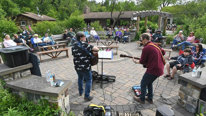 Claire Stuczynski, at left, and Eric Brewer perform at a Monday Music Series concert at Celebration Garden at the Andrew J. Conner Nature Center at Asbury Woods in Millcreek Township in 2019.