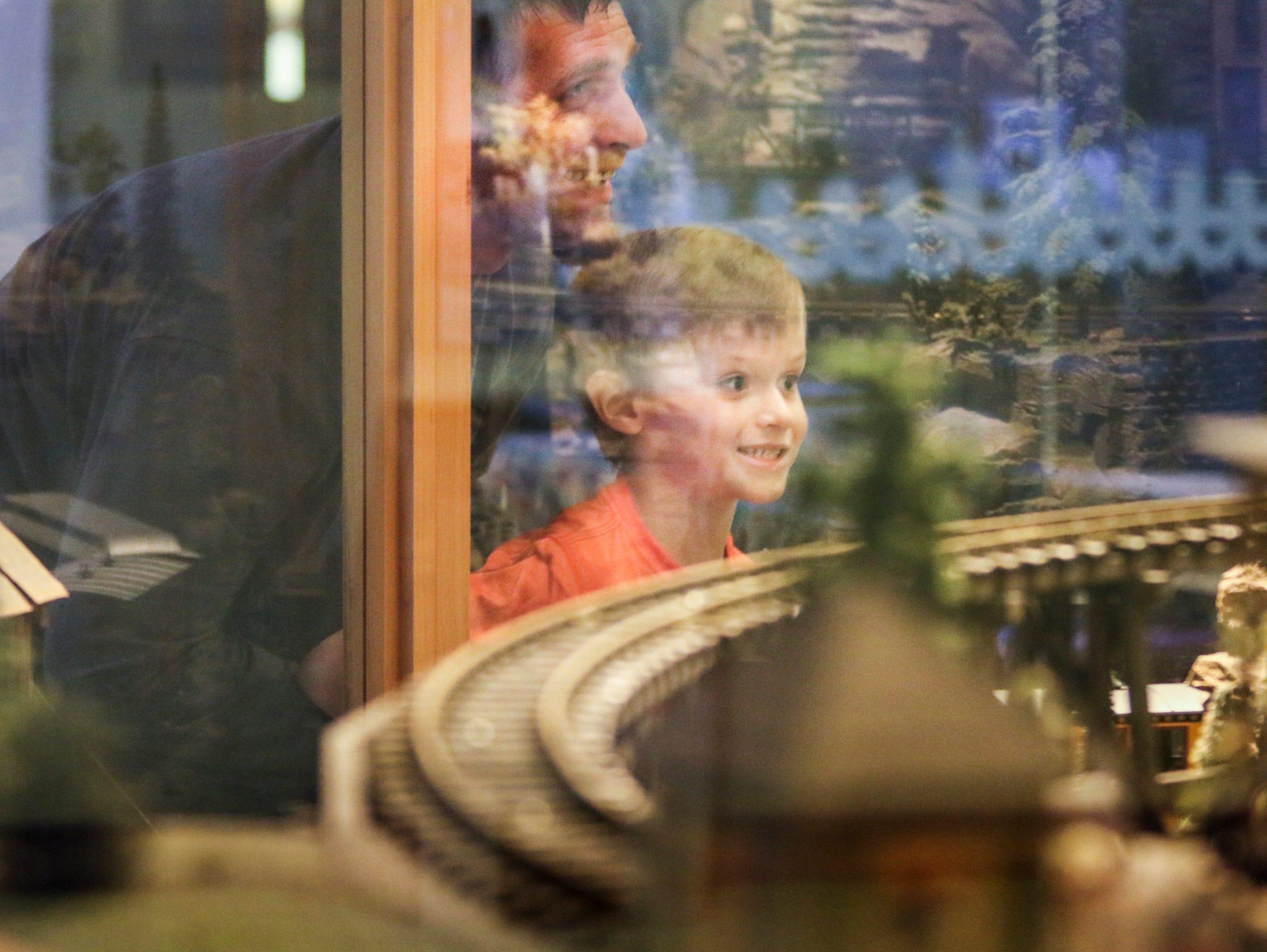 Noah Coffman, 6, and his stepdad Adam Albertson look
