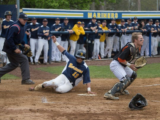 Toms River North's Joey Rose slides into home safely for second score in the first inning. Barnegat Baseball vs Toms River North in Toms River, NJ on April 7, 2016