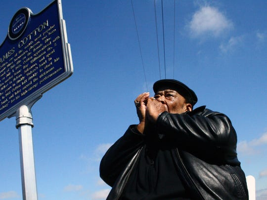 Blues legend James Cotton plays his harmonica in 2008 after the unveiling of his historic highway marker on U.S. 61 near Tunica.