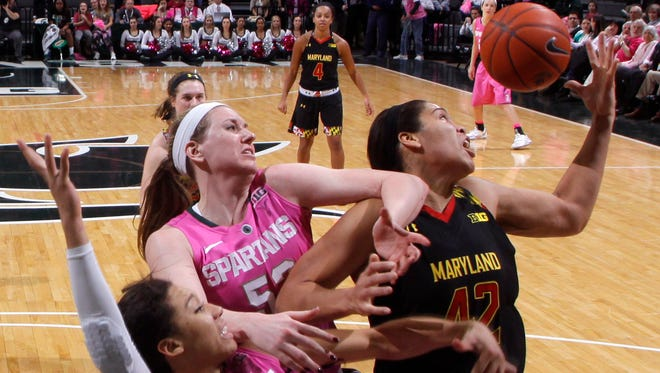 Michigan State's Aerial Powers (23) and Becca Mills, center, and Maryland's Brionna Jones, right, battle for a rebound during the second half Monday.